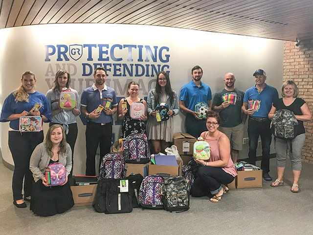 Halton's Compassion Society Partners With Guaranteed Removals To Provide 80 Backpacks to Children